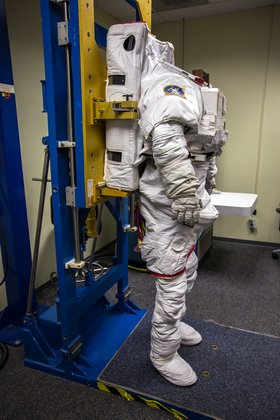 putting on a space suit - photo #12