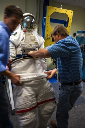 putting on a space suit - photo #7